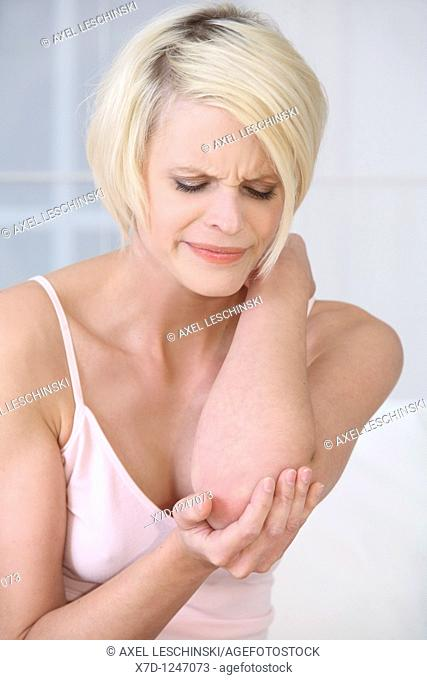 woman checking her elbow