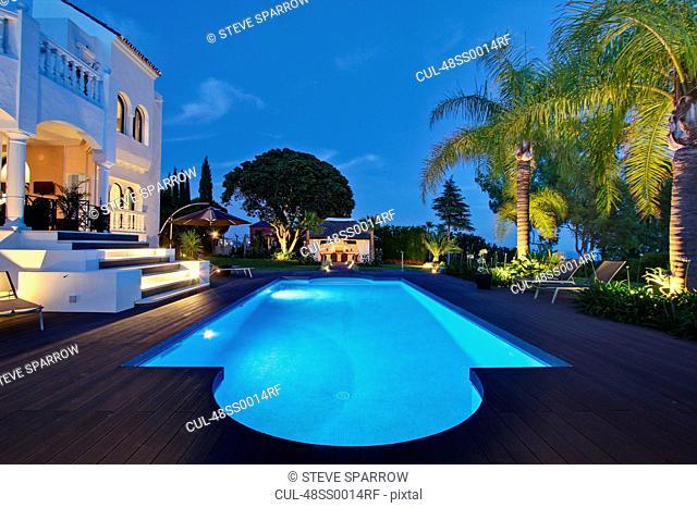 Illuminated pool outside villa