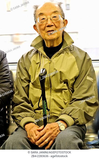 Local man inside the Metro, Hong Kong Island, Hong Kong, China, East Asia