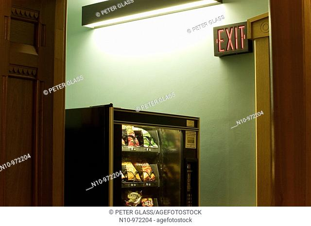 Vending machine and an exit sign in an office building