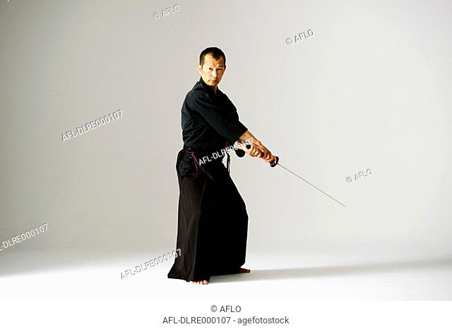 Japanese sword master performing his craft