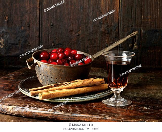 Cranberries, sherry, and cinnamon sticks