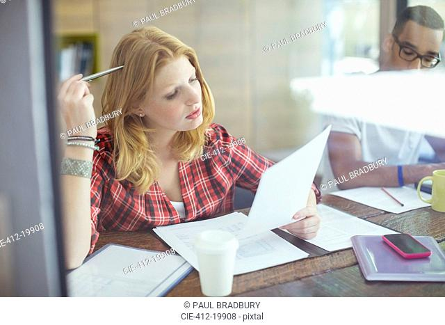 Woman working in cafe