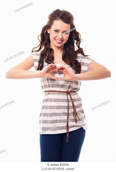 Smiling woman showing heart shape Debica, Poland