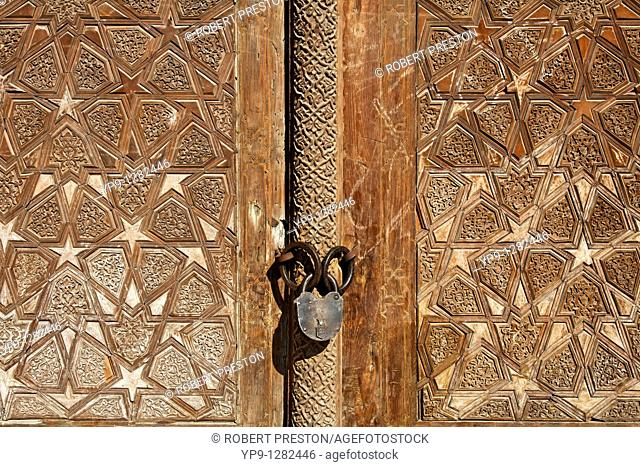 Carved wooden door at the Abdullah Khan Medressa, Bukhara, Uzbekistan