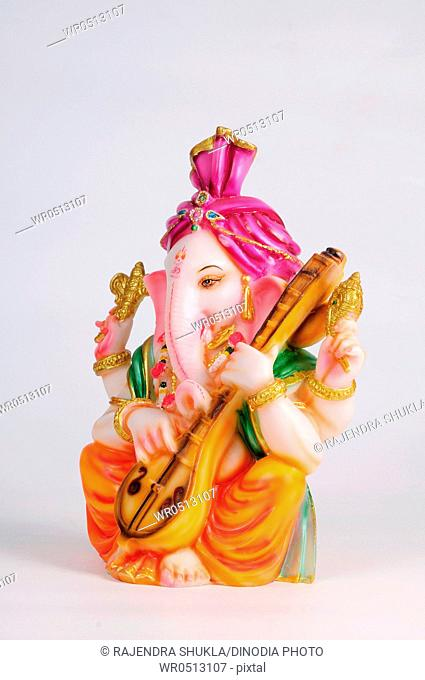 Statue of lord ganesh playing veena , India