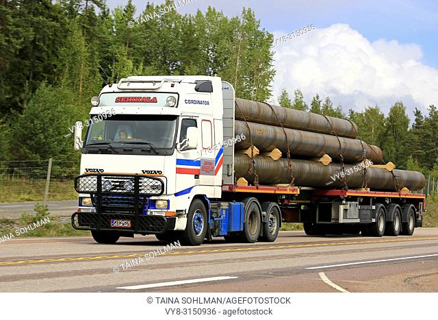 Orivesi, Finland - August 27, 2018: Volvo FH12 semi trailer of Seikkala Logistics Oy transports metallic pipes along highway 4 in early autumn
