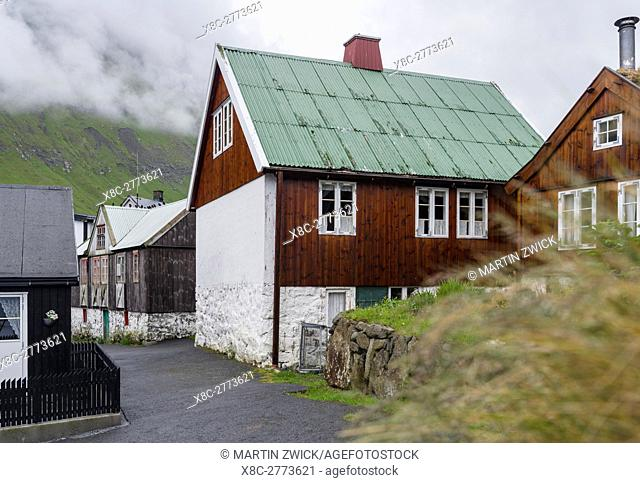 Village Elduvik located at fjord Funningsfjordur. The island Eysturoy one of the two large islands of the Faroe Islands in the North Atlantic