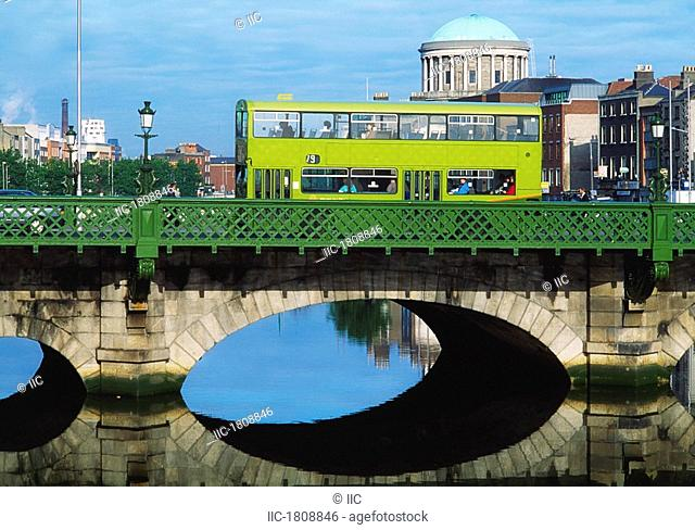 Dublin, Co Dublin, Ireland, Dublin bus going over the Capel St. Bridge with Four Courts in the background