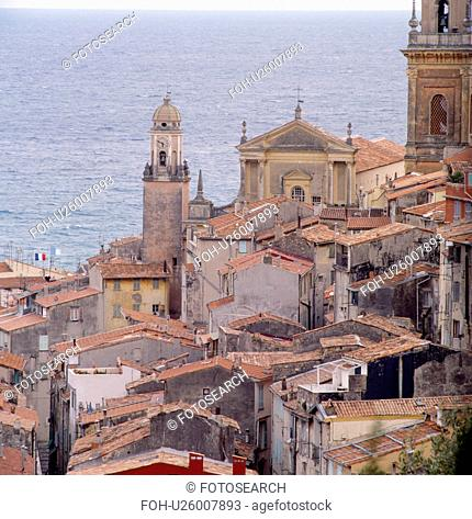 Churches and terracotta tiled roofs in the coastal town of Menton in the South of France
