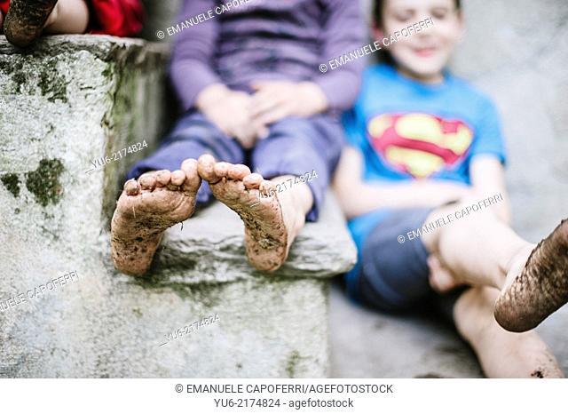 baby feet, dirty mud