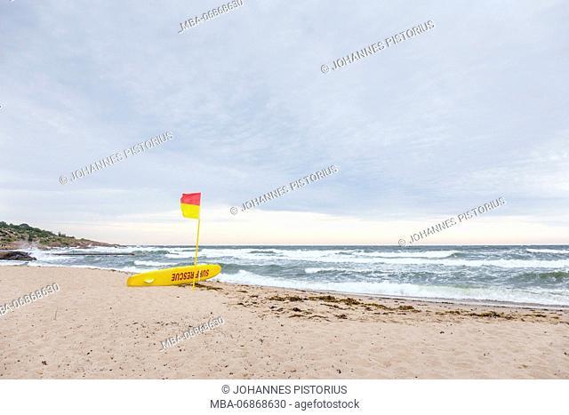 lifeguard on the beach of Sandvig, behind the stormy Baltic Sea, Europe, Denmark, Bornholm