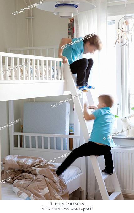 Boys playing on bunk bed