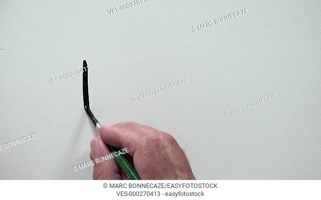 Human hand writing THE END with Black ink