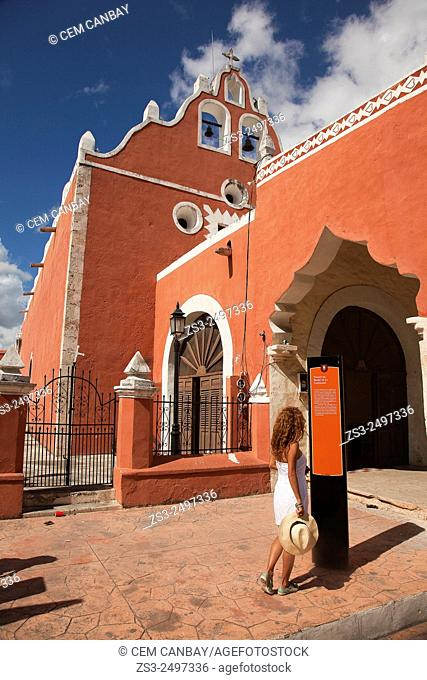 Woman in front of the Candelaria Church, building once functioned as a Franciscan Monastery, Valladolid, Yucatan Province, Mexico, Central America