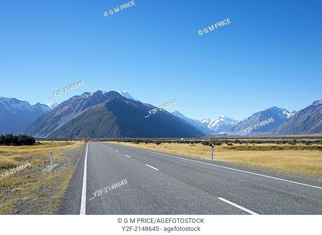 road, car and mountain range in Mount Cook Naitonal Park, New Zealand