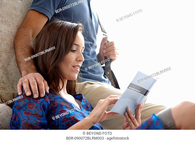 couple in city woman reading travel guide