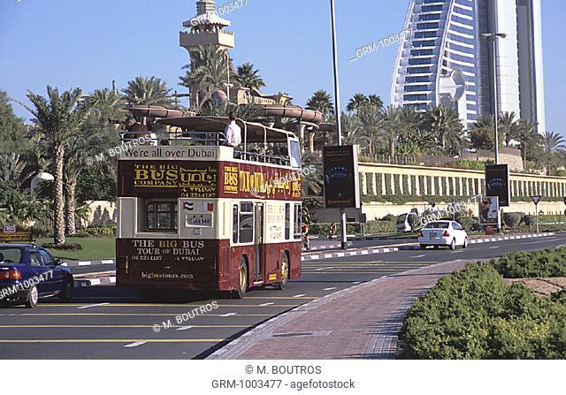 The Big Bus Company tour bus near Jumeirah Beach hotel and Wild Wadi Water park in Dubai, UAE
