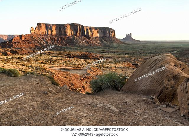 Sunrise warms buttes of Monument Valley