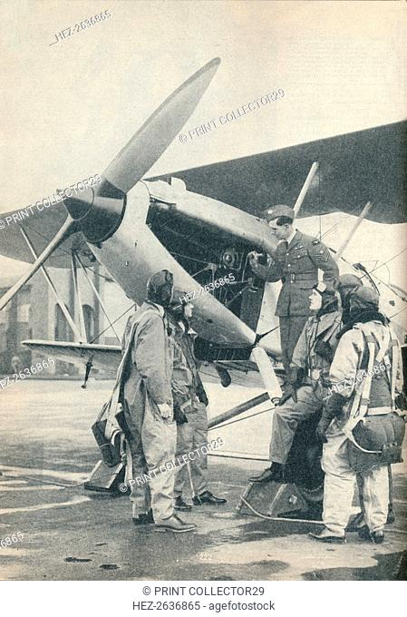 An instructor explaining engine details to a pupils at Sealand Aerodrome, Flintshire, c1936 (c1937). Artist: Unknown
