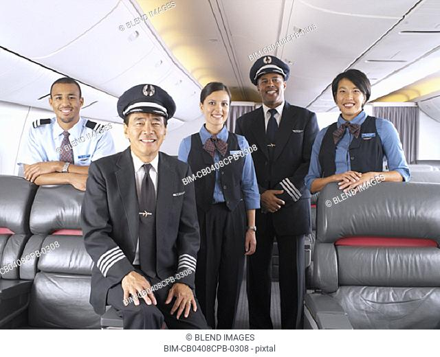 Group portrait of flight staff on airplane