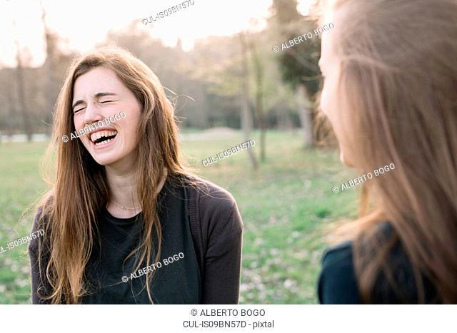 Happy girlfriends in park