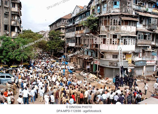 Policemen inspecting site of bomb blast also large number of people gathered to look at the site at Zaveri Bazaar in busy Kalbadevi area; Bombay Mumbai ;...