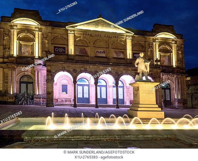Floodlit Art Gallery and Fountain in Exhibition Square at Dusk in York Yorkshire England