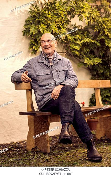 Senior man sitting on bench