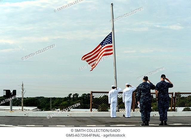 Sailors observe morning colors aboard the amphibious transport dock ship USS New York, Mayport, Florida. Image courtesy Mass Communication Specialist 1st Class...
