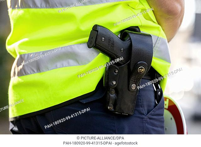 20 September 2018, Brandenburg, Oranienburg: A police officer wears a gun on his belt. The Brandenburg police also participated in a nationwide road safety...