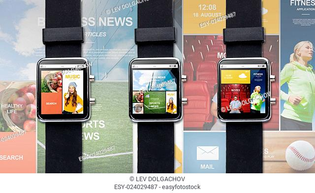 modern technology, object and media concept - close up of black smart watch with internet applications on screen