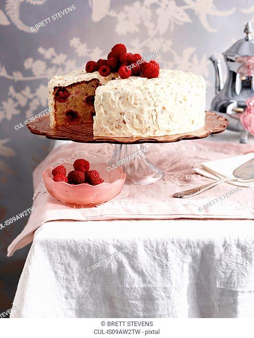 Raspberry hazelnut cake on traditional tea table