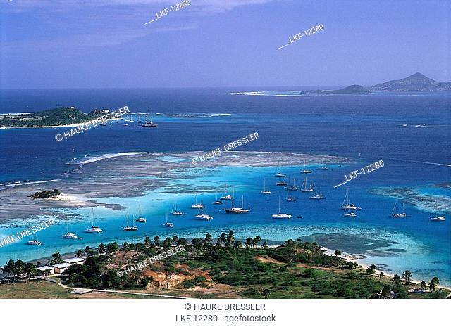 Aerial view of boats in a bay off Union Island, St. Vincent, Grenadines, Caribbean, America