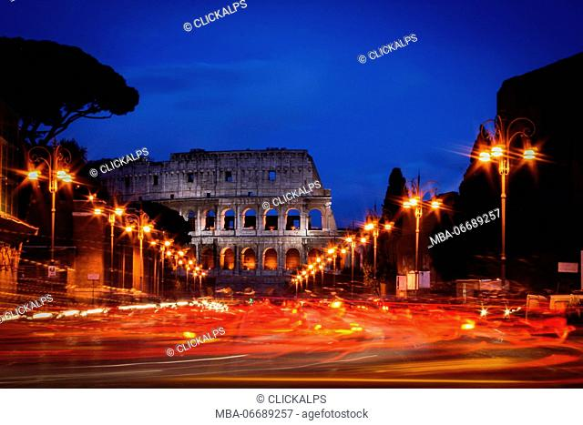 Rome, Lazio, Italy, the Colosseum wrapped in the car lights by night