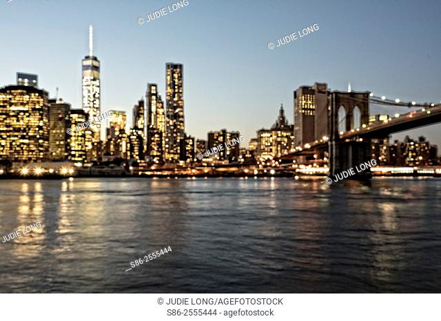 Viewing the Manhattan Downtown Skyline and the Brooklyn Bridge from the Brooklyn Side, New York City, NY, at Dusk