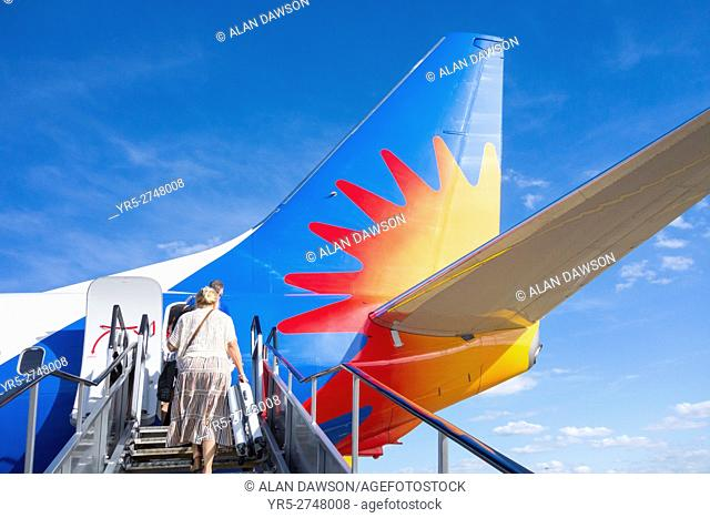 Woman boarding a Jet2. com charter flight to Spain from Leed/Bradford airport. Yorkshire, England. United Kingdom