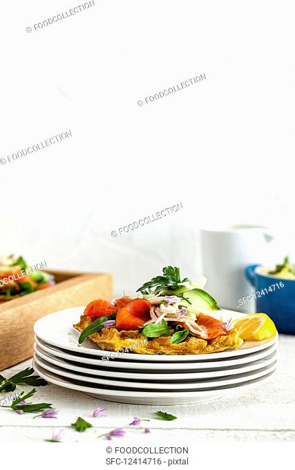 Herb waffles with smoked salmon and a fennel and cucumber salad