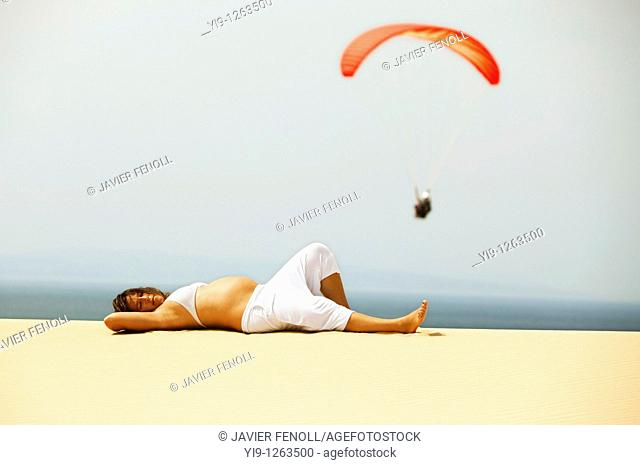 Pregnant woman relaxing on the beach