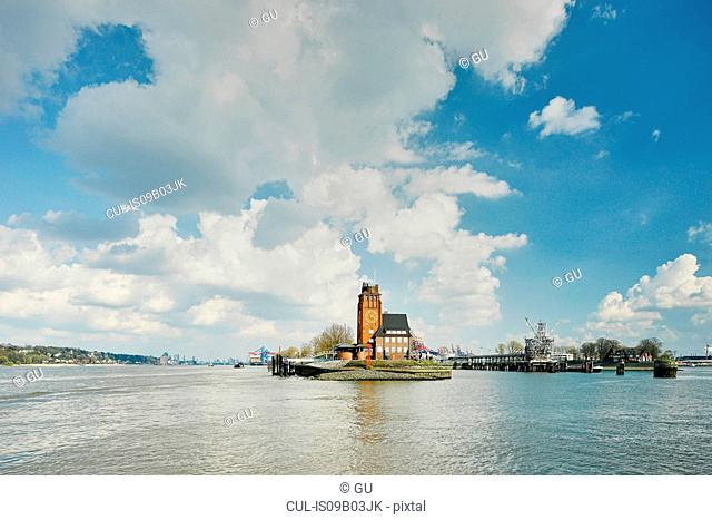 Watchtower lighthouse on river Elbe peninsula, Hamburg, Germany