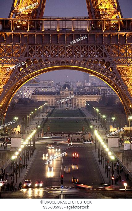 Night view of Eiffel Tower with Champ-de-Mars and Ecole Militaire in background, Paris. France