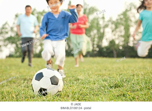 Chinese family playing soccer