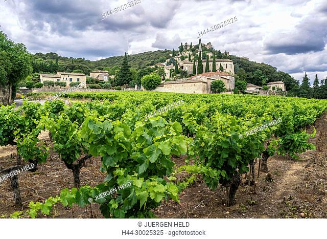 Hilltop village of La Roque-sur-Ceze with a vineyard in the foreground