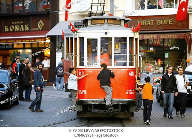 Kids on the tram that goes along Istiklal Caddesi Istanbul's main shopping street in Beyoglu quarter Istanbul, Turkey