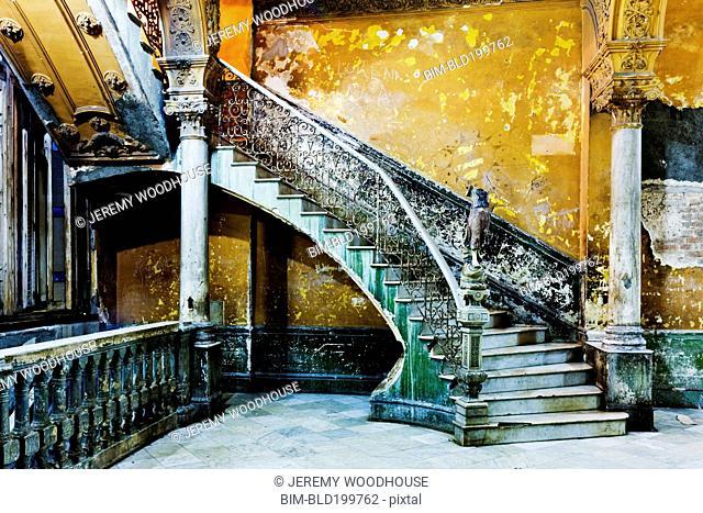 Dilapidated, ornate stairway