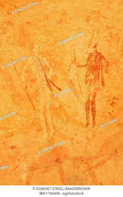 Neolithic rock art, painting of warriors, hunters with bow and arrow, Tasset Plateau, Tassili n'Ajjer National Park, Unesco World Heritage Site, Wilaya Illizi