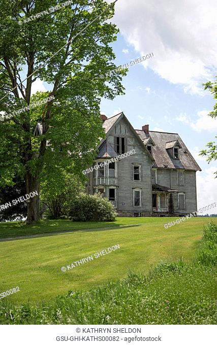 Abandoned House with Mowed Lawn