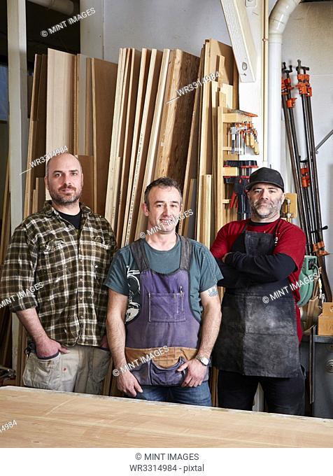 Carpenters smiling in workshop