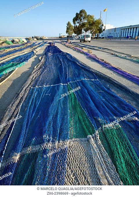 Fishing nets extended over wharf. Sant Carles de la Rapita fishing harbor. Ebro Delta Natural Park. Tarragona Province, Catalonia, Spain