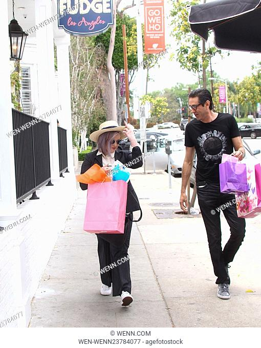 Kelly Osbourne and a friend arrive at Au Fudge in West Hollywood with gift bags in hand Featuring: Kelly Osbourne Where: Los Angeles, California